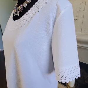 White laser-cut-out top